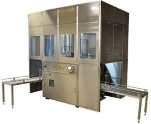 Solvac Automatic hermetically sealed vapour/liquid cleaning system conveyor fed.